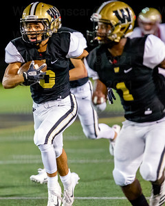 Saadiq Hinton #3  runs with the ball after intercepting the Oakton QB, and takes the ball 40 yards for pick 6.