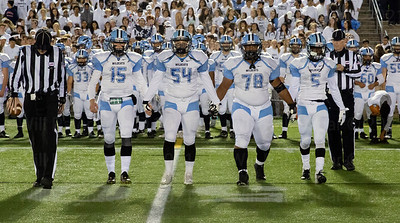 Centreville team captains walk onto the field for the coin toss of their game with Westfield.