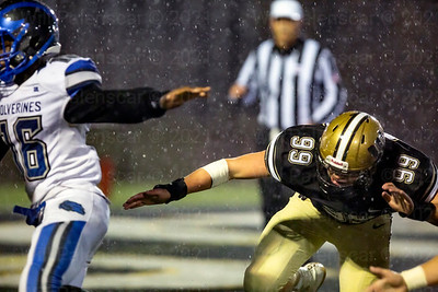 Tyree Davis #16 tries to avoid the rush of Richie Aguilar #99  of Westfield