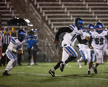 west Potomac's Micah Mcdonald #6 looks to follow behind Tyree Davis #16 in game with Westfield