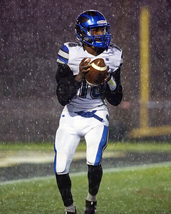 Tyree Davis #16 looks down the field for a West Potomac receiver