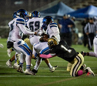 Israel McClain #1 brings down West Potomac ball carrier Micah Mcdonald #6