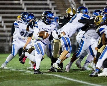 Micah Mcdonald #6 tries to run for positive yardage for West Potomac
