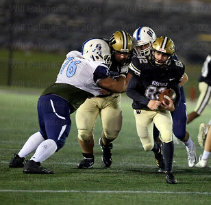 Michael Richie #82 carries the ball for Westfield as an offensive lineman clears a path
