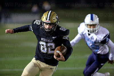 Westfield's Michael Richie #82 runs with ball for positive yardage during game with Yorktown