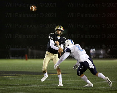 Westfield QB Noah Kim #10 passes the ball down the field before York \town defender Jack McCool #2 can sack him