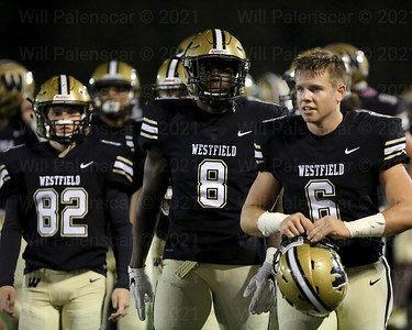 Michael Richie #82, Eugene asante #8 and Joe Clancy #6 await the start of the 1st round playoff game with Yorktown