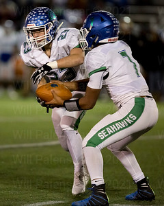 Marcus Miles #7 hands off to teammate Nicholas Napolitano #23 . Napolitano carried the ball 5 tiems for 17 yards for south Lakes.