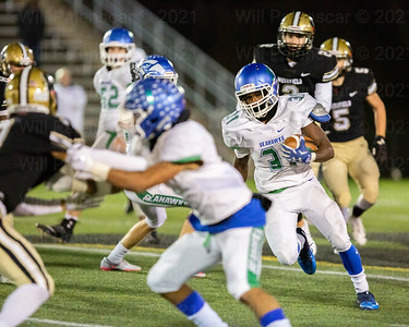 James Earl #31 carries the ball for South Lakes