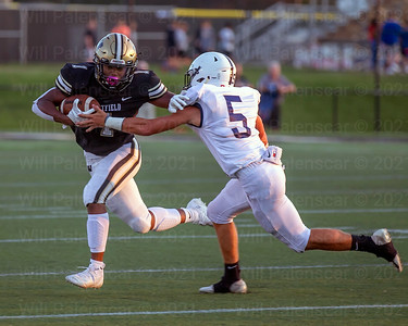 Isaiah Daniel  #1 runs for positive yardage in game with John Champe HS.