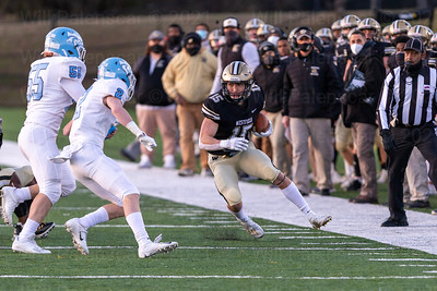 Alex Richards #15 looks for room to run after a reception