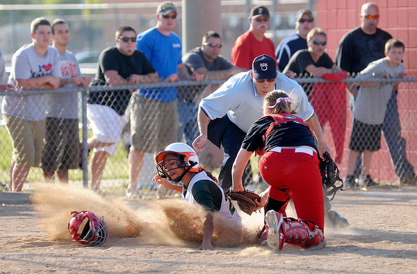 Frankton catcher Lexi Gray tags Anderson's Kaira Jackson out at home as the Eagles hosted the Indians on Wednesday.