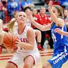 John P. Cleary | The Herald Bulletin<br /> Frankton's Ashtyn Rastetter looks toward the basket as she drives the baseline.