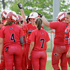 Don Knight   The Herald Bulletin<br /> The Eagles meet Lexi Gray at home plate after she hit a grand slam, her third home run of the game, during sectional action at Lapel High School on Tuesday.