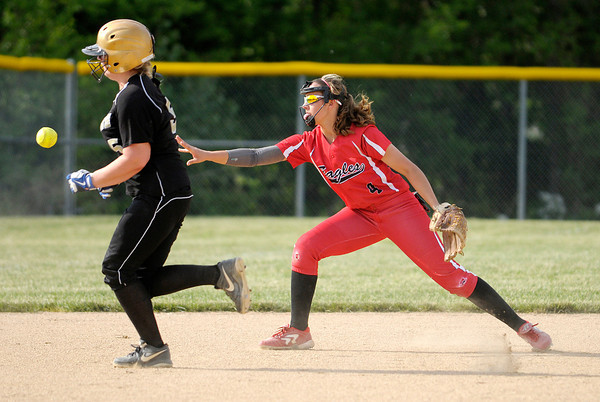 Don Knight   The Herald Bulletin<br /> Frankton short stop Caitlyn Clark throws the ball to Tia Sharp at third base to force Winchester's Brianna Weist out during sectional action at Lapel High School on Tuesday.