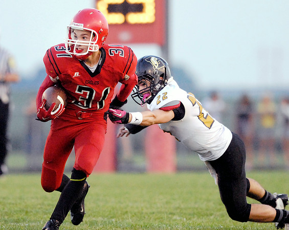John P. Cleary | The Herald Bulletin<br /> Frankton's Austin Compton avoids Lapel's John Sherwood to gain yardage.<br /> For a gallery of photos to view or purchase, visit<br /> photos.heraldbulletin.com.
