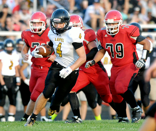 John P. Cleary | The Herald Bulletin<br /> Lapel's Joe Hart runs upfield as Frankton defenders try to chase him down in first half action of their game Friday.