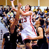 Frankton's Aaron Korn splits the Winchester defenders and goes up for a basket.