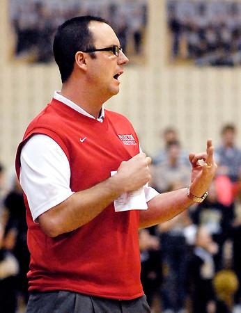Frankton's head coach Brent Brobston signals the play he wants run.