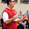 Frankton's head coach Brent Brobston signals the play he wants run.
