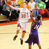 Don Knight / The Herald Bulletin<br /> Anderson's Aaron Karr drives for a layup against Marion's Jordan Smith as the Indians hosted the Giants on Friday.