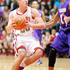 Don Knight / The Herald Bulletin<br /> Anderson's Grant Bennett drives into the paint against Marion's Vijay Blackmon as the Indians hosted the Giants on Friday.