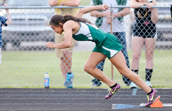 Don Knight | The Herald Bulletin<br /> Pendleton Heights' Kiawna Cottrell comes out of the blocks at the start of the 400 meter dash during the Girls Track Sectional at Pendleton Heights on Tuesday. Cottrell beat her own meet record set last year with a time of 43.59 seconds.