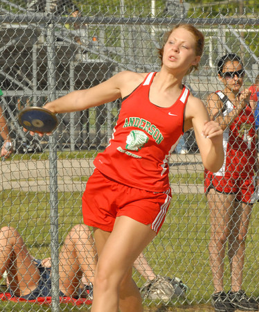 Amber Gilmore throws the discus for Anderson High School.