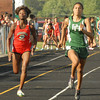 Anderson High School's Deborah Gardner and Pendleton Heights' Kiawna Cottrell head for the finish line in the 100 meter dash.