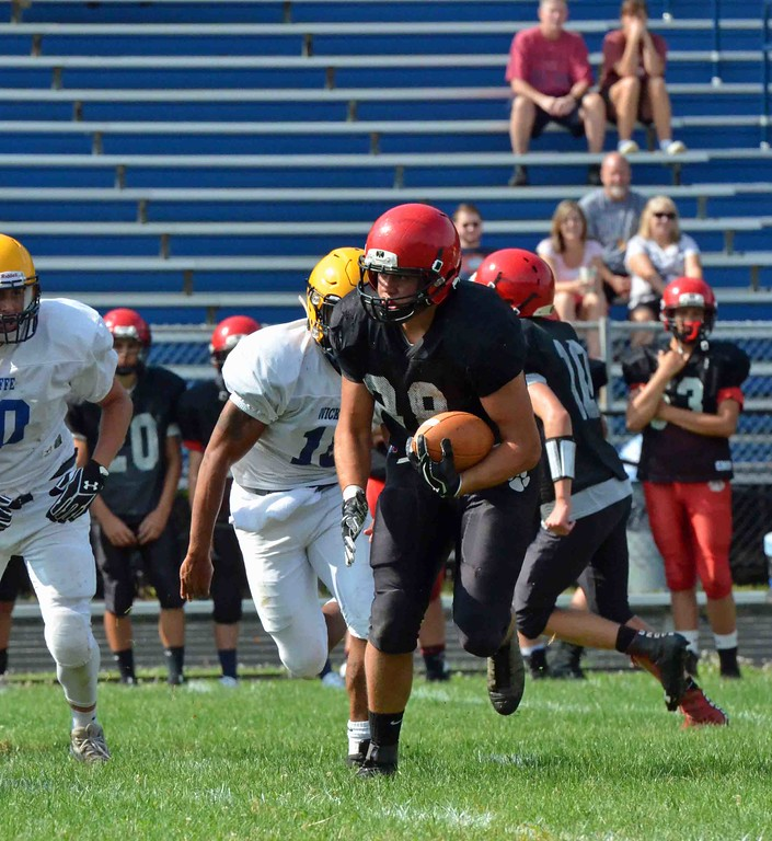 . Paul DiCicco - The News-Herald Scenes from the scrimmage between Cardinal and Wickliffe at Wickliffe on Aug. 12.