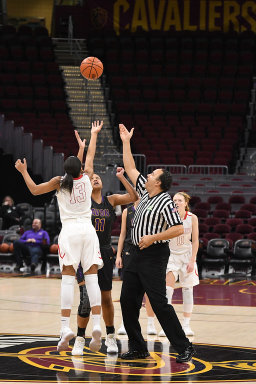 . Eric Bonzar�The Morning Journal<br> Avon\'s Amari Davidson and Wadsworth\'s Lexi Lance tip off the Eagles\' and Lady Grizzlies\' game, at Quicken Loans Arena, Jan. 2, 2018.