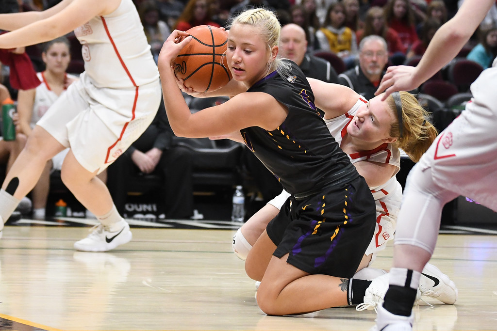 . Eric Bonzar�The Morning Journal<br> Avon\'s Karlee Clements rips a loose ball away from Wadsworth\'s Taylor Leatherman, Jan. 2, 2018.