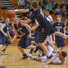 Eric Bonzar—The Morning Journal<br /> Olmsted Falls' Adam Skutt (10) saves the ball from going out of bounds,  Jan. 13, 2017.