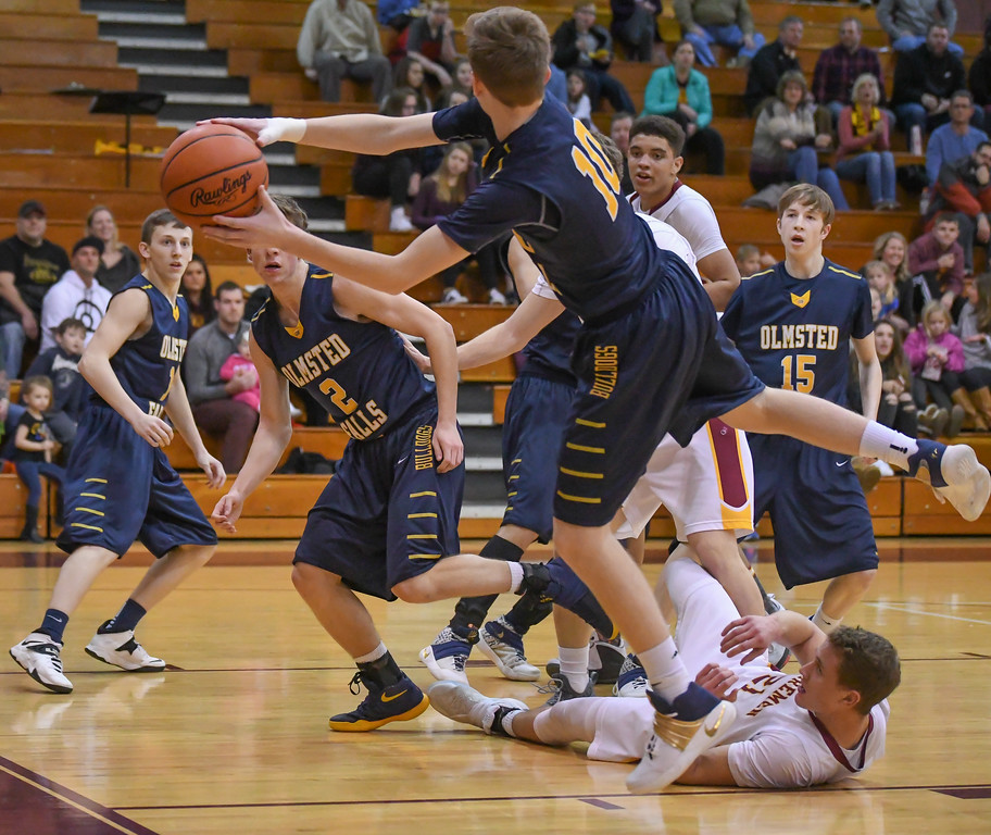 . Eric Bonzar�The Morning Journal Olmsted Falls\' Adam Skutt (10) saves the ball from going out of bounds,  Jan. 13, 2017.