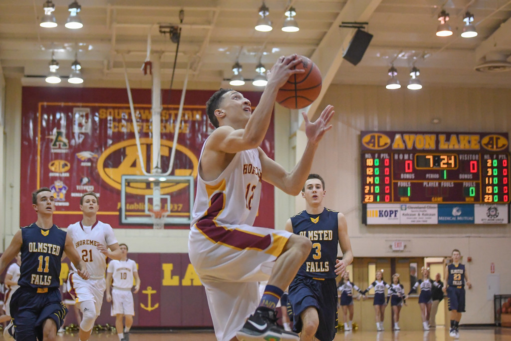 . Eric Bonzar�The Morning Journal Avon Lake\'s Jordan Ball (12) soars to the rim to put the Shoremen on the board first, Jan. 13, 2017.