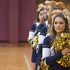 Eric Bonzar—The Morning Journal<br /> Olmsted Falls Bulldogs cheerleaders place their hands over their hearts as the Avon Lake band plays the The Star Spangled Banner,  Jan. 13, 2017.