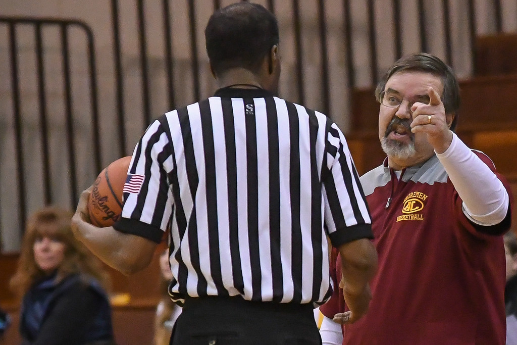 . Eric Bonzar�The Morning Journal Avon Lake head coach Eric Smith argues a call with an official, Jan. 13, 2017.
