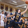 Eric Bonzar—The Morning Journal<br /> Olmsted Falls' Chuck Backus (24) snags a rebound, Jan. 13, 2017.