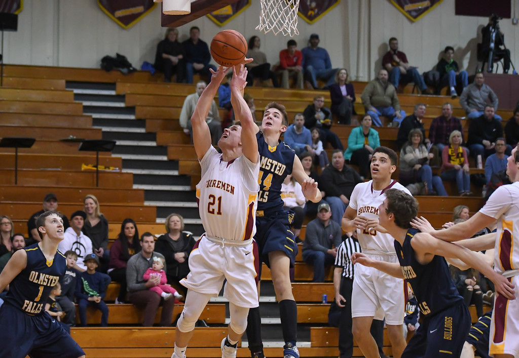 . Eric Bonzar�The Morning Journal Avon Lake\'s Carson Toy (21) has his shot blocked by Olmsted Falls\' Gavin Dietrich (44), Jan. 13, 2017.