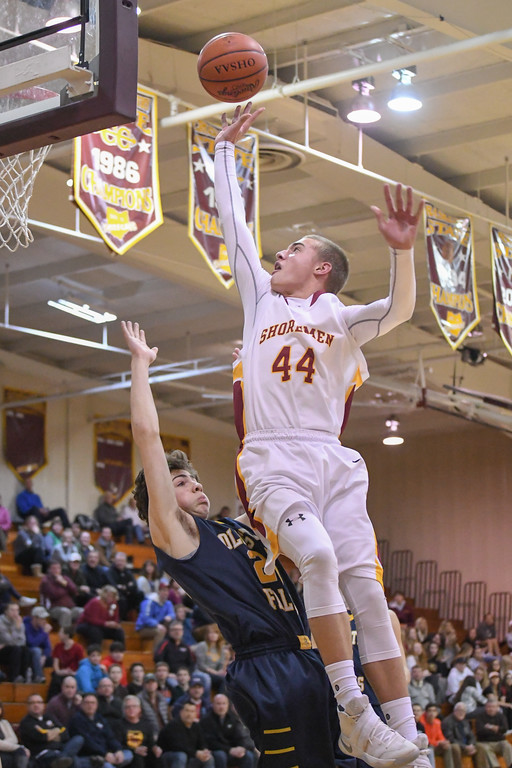 . Eric Bonzar�The Morning Journal Avon Lake\'s Tanner Russell (44) draws the foul as he runs in to Olmsted Falls guard Chuck Backus (24) on his way to the rim, Jan. 13, 2017.