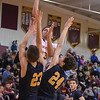 Eric Bonzar—The Morning Journal<br /> Avon Lake's Barris Coleman (23) shoots a jumper over Olmsted Falls' Braden Galaska (23) and Chuck Backus (24), Jan. 13, 2017.