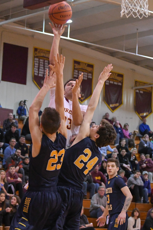 . Eric Bonzar�The Morning Journal Avon Lake\'s Barris Coleman (23) shoots a jumper over Olmsted Falls\' Braden Galaska (23) and Chuck Backus (24), Jan. 13, 2017.