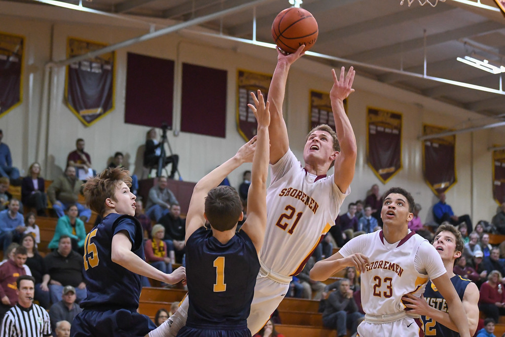 . Eric Bonzar�The Morning Journal Avon Lake\'s Carson Toy (21) shoots over Olmsted Falls guard Matt Johnson (1), Jan. 13, 2017.