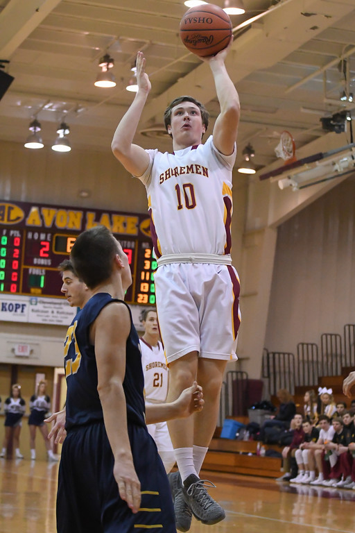 . Eric Bonzar�The Morning Journal Avon Lake\'s David Marsh (10) shoots a jumper over Olmsted Falls\' Braden Galaska (23), Jan. 13, 2017.