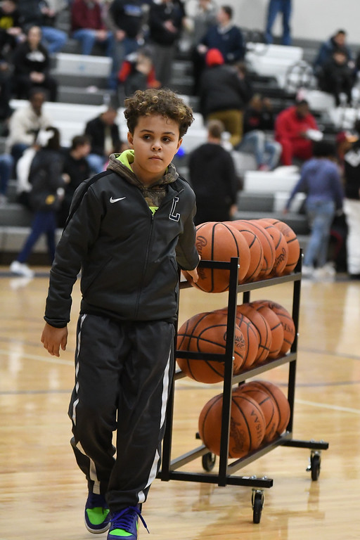 . Eric Bonzar�The Morning Journal<br> The Lorain Titans hosted the Warrensville Heights Tigers in a Lake Erie League Conference match-up, Jan. 26, 2018. The Titans beat the Tigers 80-49.