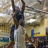 Eric Bonzar—The Morning Journal<br /> Lorain's Octavious Wilson (1) snags a rebound over Cleveland Heights guard Yahell Hill (3), Jan. 27, 2017.