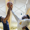 Eric Bonzar—The Morning Journal<br /> Lorain's Octavious Wilson (1) and Cleveland Heights forward Tyreke Smith (4) battle for a rebound under the hoop, Jan. 27, 2017.