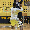 Eric Bonzar—The Morning Journal<br /> Lorain's Naz Bohannon (33) pulls up a jump shot over the defense of Cleveland Heights forward Tyreke Smith (4), Jan. 27, 2017.