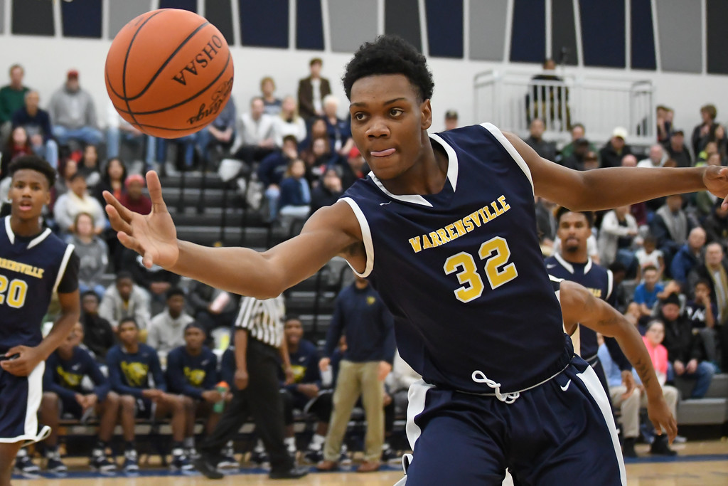 . Eric Bonzar �The Morning Journal Warrensville Heights\' DaQuan Henderson (32) snags the ball before going out of bounds, Feb. 10, 2017.