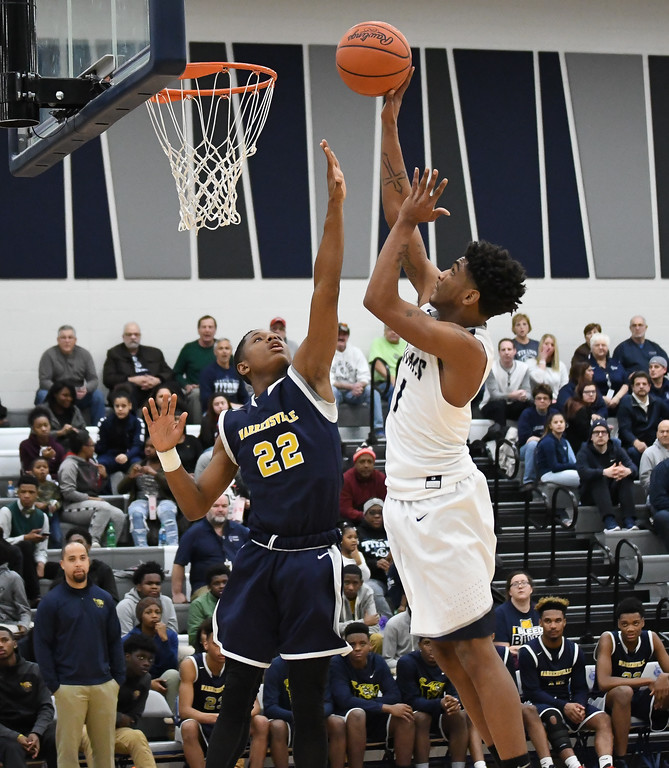 . Eric Bonzar �The Morning Journal Lorain\'s Octavious Wilson (1) shoots a one-handed jumper over the defense of Warrensville Heights\' Travis Torian (22), Feb. 10, 2017.